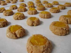 Fill indented cookies with Jam