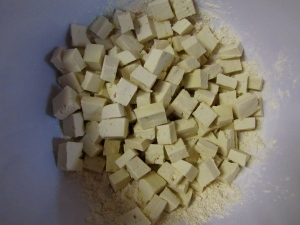Cubed tofu in cornstarch mixture